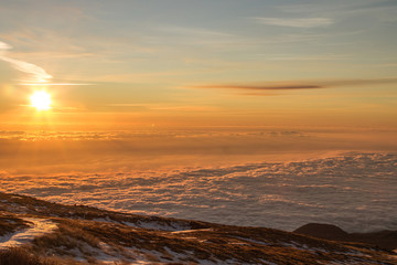 Sunrise. Etna volcano with snow