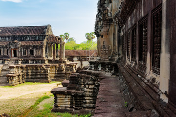 Wall Mural - Library building and wall of Angkor Wat in Siem Reap, Cambodia