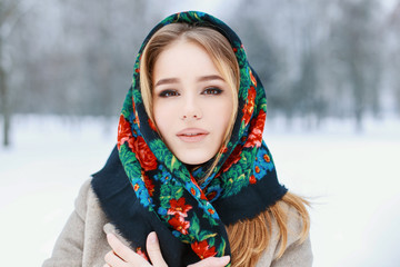 Portrait of a Russian woman in a winter snowy day.