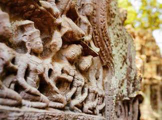 Wall Mural - Ancient bas-relief at Ta Prohm temple in Angkor, Cambodia