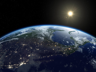 Earth from satellite. Beautiful sunrise over North America. Earth at night and in daytime.