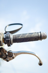 Closeup on handlebar of a motorcycle