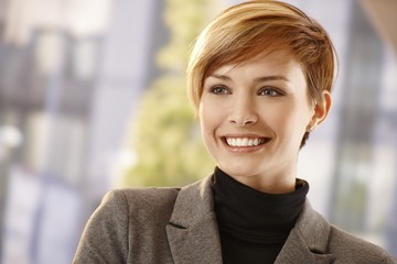 Outdoor portrait of attractive young businesswoman