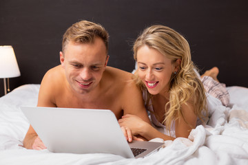 Couple looking at something on computer