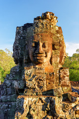 Wall Mural - Enigmatic face-tower of Bayon temple in evening sun. Cambodia