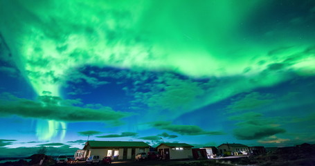 Wall Mural - Aurora Borealis over houses in Iceland