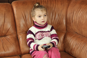 little girl with remote control in hands