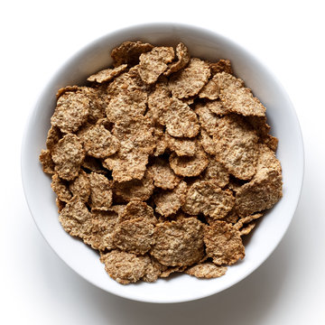 Wheat bran breakfast cereal in bowl.