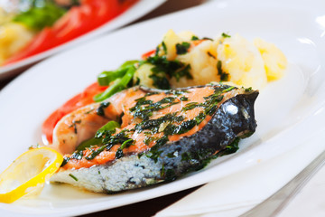 Cooked salmon fish on the plate