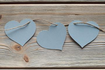 Three paper heart on wood