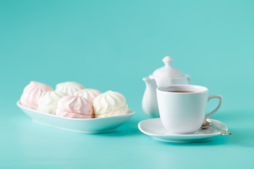 Pastel colored marshmallow and cup of tea