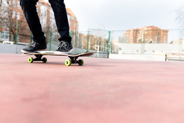 Man on his Skate while moving on a Court