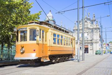"The historical trasportation of Porto - on background the ""Igreja do Carmo"""