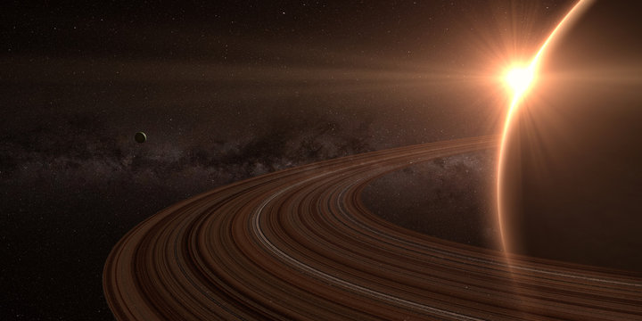 planet saturn with rings at sunrise on the space background