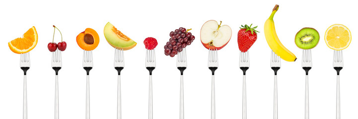 row of tasty colorful fruits on forks isolated on white background