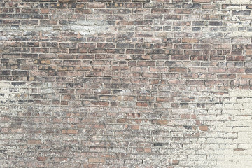 Old red brick wall with white paint background texture