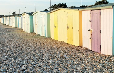 Traditional British beach huts at Uk seaside