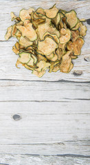 Dried zucchini or courgette over wooden background