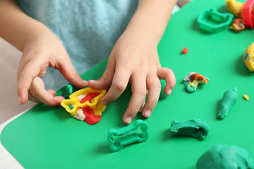Child sculpts from plasticine, closeup