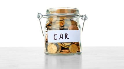 Jar for savings full of coins