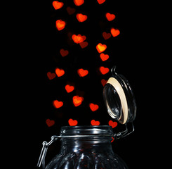 Miracle of love from glass jar on black background