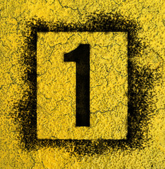 Stencil Number in spray paint on yellow background