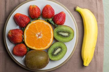 orange kiwi strawberry and banana