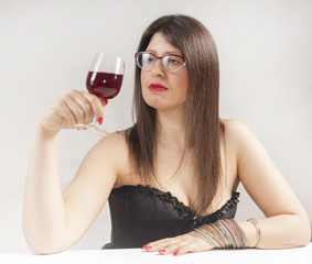 Young woman with glass of wine. Studio. White.