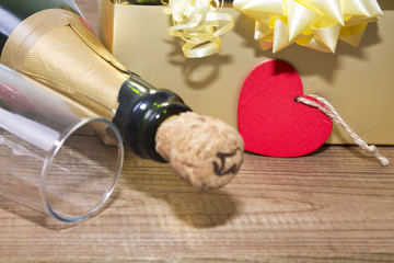 gift boxes with champagne and heart label