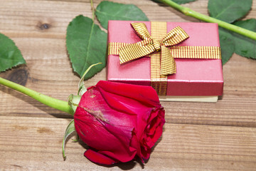 red roses with gift boxes