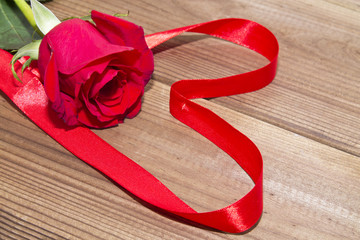 red roses with ribbon heart