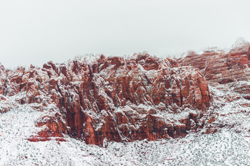 Red mountain with snow haze at sunset, USA