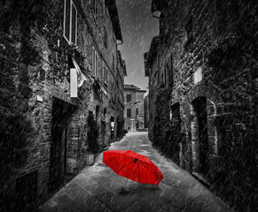 Fotomurales - Umbrella on dark street in an old Italian town in Tuscany, Italy. Raining.