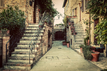 Fototapete - Charming old medieval architecture in a town in Tuscany, Italy.