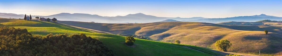 Tuscany landscape panorama at sunrise with a chapel of Madonna d