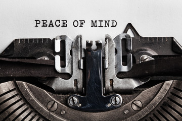typewriter with Peace of mind sign