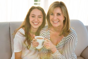 Mother and daughter drink tea