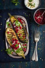 grilled eggplants with garlic yogurt sauce, walnuts and pomegran