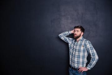 Pensive man looking up at copyspace