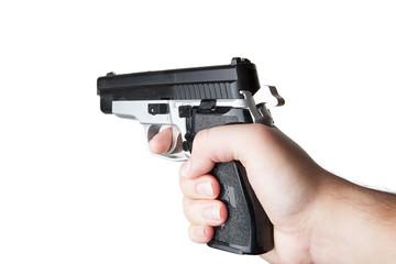 Pistole in der Hand vor weissem Hintergrund