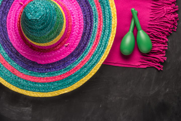 Mexican background with sombrero, blankets and maracas