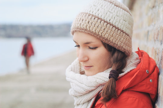 Young thoughtfull woman in winter