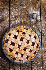 tart with berries jam on wooden background