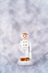 Celestial boy soldier figure in porcelain surrounded by clouds.