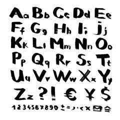 Alphabet and symbols from black brush strokes on white background