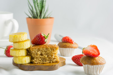 Delicious banana cake decorated with strawberry, berry sweet.