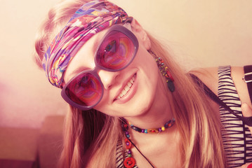 Portrait of a smiling hipster girl in exclusive glasses.
