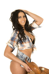 cowgirl short denim shorts hold saddle hand in hair