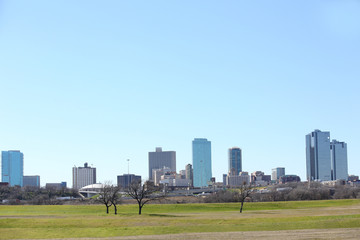 Cityscape view of Fort Worth, Texas skyline from the banks of the Trinity River