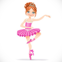 Cute brunette ballerina girl dancing in pink dress isolated on a